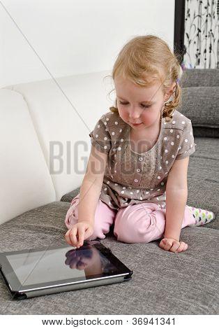 Cute Little Girl Using Tablet Computer