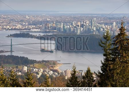 Vancouver Burrard Inlet Freighter And Cityscape. The View Looking Down Over Burrard Inlet And Downto