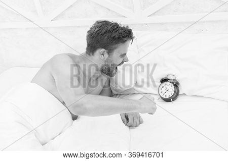Man Angry Because Alarm Rings. Angry Man Lying In Bed Early In Morning. Stop Ringing. Sleep Longer.