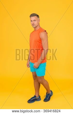 Fit Body Is Your Choice. Fit Man Yellow Background. Strong Athlete Wear Gym Clothes. Fit Club. Sport