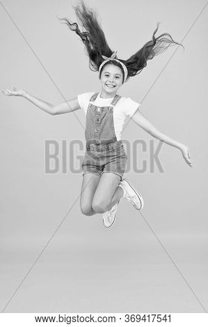 Full Of Energy. Active Girl Feel Freedom. Fun And Relax. Feeling Free. Carefree Kid On Summer Holida