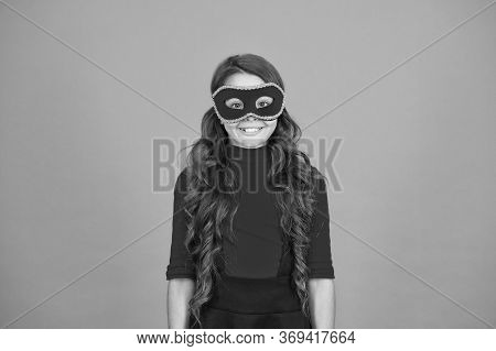 Creating Mysterious Carnival Look. Happy Child Wear Carnival Mask. Carnival Party. Holiday And Festi