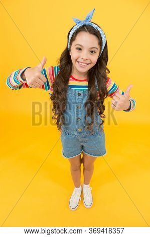 Definitely Best Girl. Happy Girl Give Thumbs Up Yellow Background. Fashion Look Of Baby Girl. Little