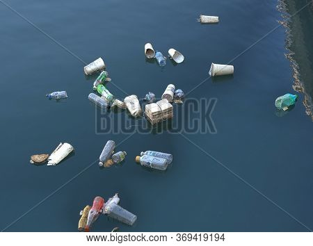 Kaohsiung, Taiwan -- June 2, 2019: Plastic Bottles And Polystyrene Cups Pollute Kaohsiung Harbor