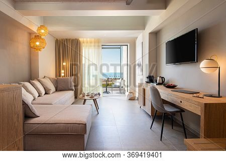 Beige Textile And Light Oak Wood Furniture Interior Of Modern Living Room Interior With Workplace Ta