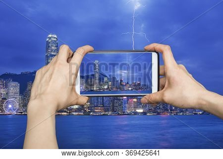 Pictures On Mobile Smart Phone In Thunderstorm Hongkong Cityscape At Night , Hong Kong City.