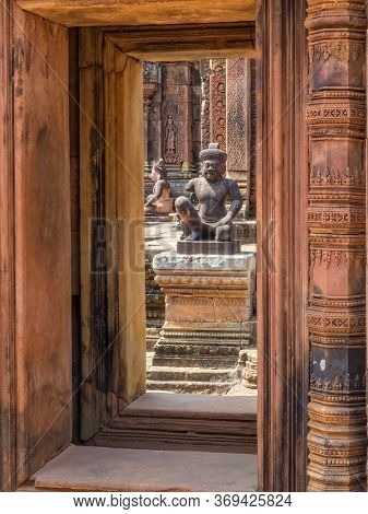 Kneeling Guardians Keep Watch Over The Interior Of The 'citadel Of The Women' -  Banteay Srei, Cambo