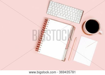 Minimal Women Office Desktop With Keyboard, Pen, Coffee Cup And Notebook On Pink Background. Flat La