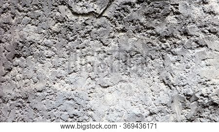 Stone Rock Texture Or Background. Gray Rocky Uneven Surface, Natural Seamless Backdrop For Design. C