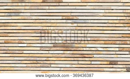 Decorative Texture Of A Beautiful Wall With Rectangular Parts Made Of Multi-colored Artificial Stone