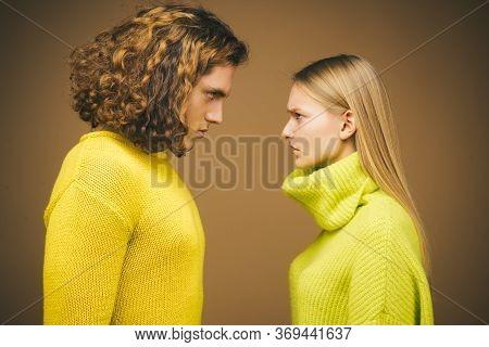 Young Fashionable Couple. Fashion Photo Of Elegant Couple In Studio. Couple Portrait On Yellow Backg