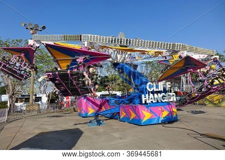 Kaohsiung, Taiwan -- January 11, 2020: People Enjoy A Thrilling Experience Riding On The Cliff Hange