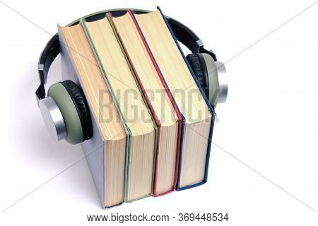 Book With Headphones On On A White Background Audiobooks To Listen To Alone