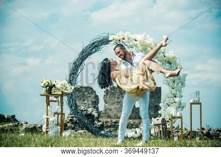 Wedding Couple. Bride And Groom On Wedding Ceremony. Wedding Couple In An Summer Decor. Ceremony In