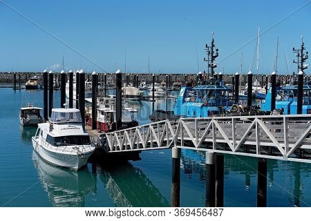 Mackay, Queensland, Australia - June 2020: Luxury Boats And A Tug Boat Moored At The Marina