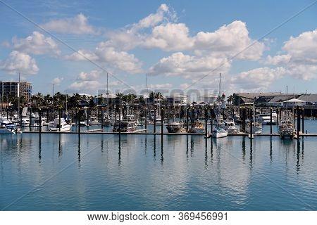Mackay, Queensland, Australia - June 2020: Luxury Boats Moored At Marina Berths In Calm Blue Water