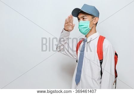 Indonesian Senior Student Of Senior High School In Indonesian Wearing Protection Face Mask With Scho