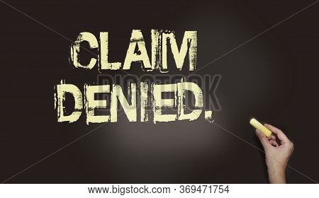 Claim Denied, Blackboard With Text And Hand Holding Piece Of Cahlk. Insurance Payment Request Deny C