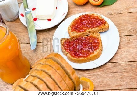 Healthy Vegetarian Meal, Homemade Apricot Jam, Apricot Marmalade, Butter And Milk On Table