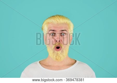 Blond Hipster Guy. Handsome Man With Stylish Haircut. Bearded Man With Dyed Blonde Hair. Modern Hand