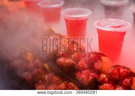 Chilled Freshly Squeezed Pomegranate Juice In A Transparent Plastic Cup For Sale On A Stall In Musli