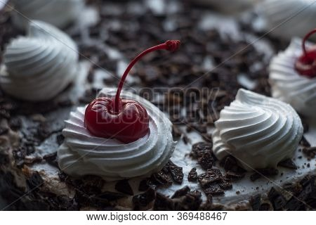 Closeup Of A Cherry Chocolate Cake With White Cream. Red Cherry, Cream Chocolate Cake, Cherry Sponge