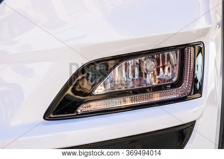 Close Up Photo Of Modern Car, Detail Of Headlight. Headlight Car Projector Led Of A Modern Luxury Te