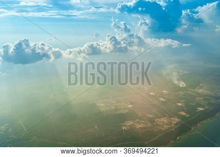 Beautiful landscape with clouds and mountain. View from the window of airplane.