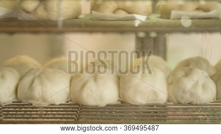 The Delicious White Loaf Of Steamed Buns On The Stainless Shelf In The Steam With Copy Space