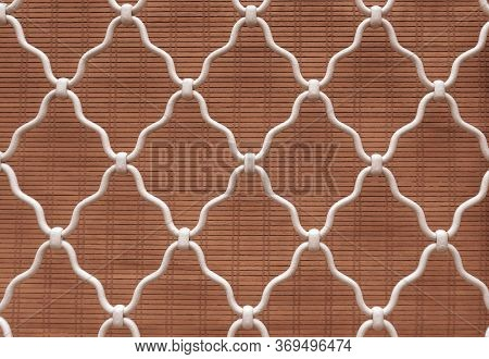 Diamond Shape Of White Curved Wrought Iron Steel On The Lattice Window, Brown Bamboo Curtain Backgro