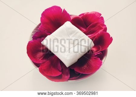 Cloth Menstrual Pads. Reusable Cloth Daily Pads On Red Petals On White Background. Zero Waste Suppli