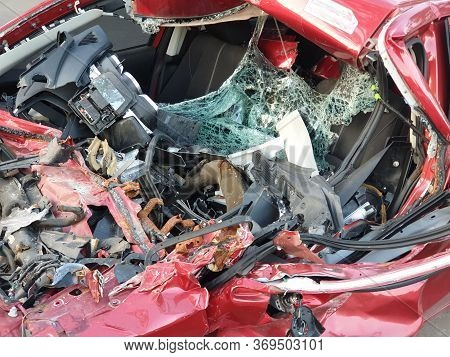 Red Car Crash Background.red Car Accident Shattered And Crumpled.