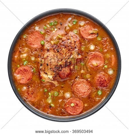 Chicken And Sausage Gumbo Soup In Black Bowl Isolated On White Backdrop. Gumbo Is Louisiana Cajun Cu