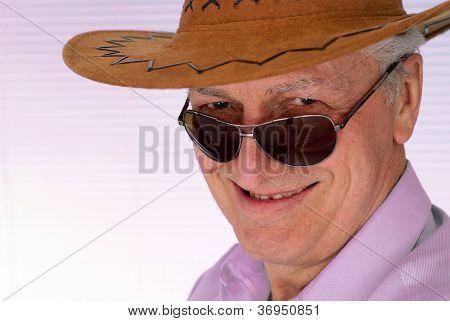 Elderly man in a cowboy hat feels fine
