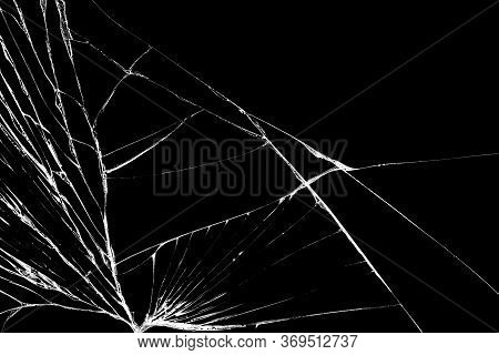 Black Cracked Touch Screen Phone. Cracks And Scratches On The Surface. Abstract Broken Glass Backgro
