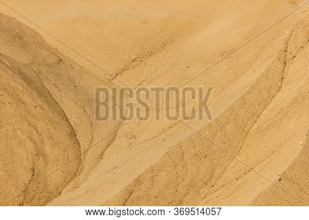 Texture Of River Or Sea Sand Close-up. Sand Texture. Brown Sand. Background From Fine Sand.