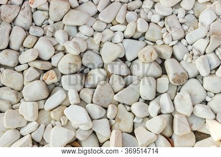 White Pebbles. Background Of Natural White Pebbles With Sparkles.