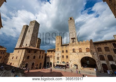 San Gimignano, Tuscany, Italy - July 12, 2014: Piazza Del Duomo (cathedral Square) In San Gimignano