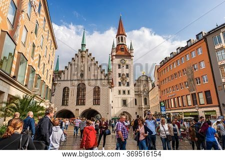 Munich, Germany - Sept 7, 2018: Tourists And Locals Stroll In Marienplatz, The Town Square. On Backg