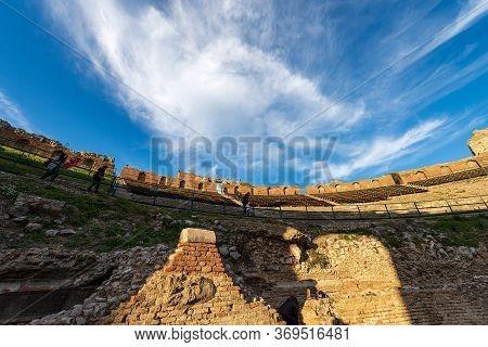 Taormina, Sicily Island, Italy, Dec 8, 2017: Ancient Greek And Roman Theater At Sunset In Taormina T