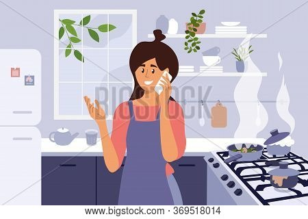 Young Mom Cooking Homemade Meal. Cute Woman Distracted By Phone Call And Set Kitchen Fire. Busy Girl