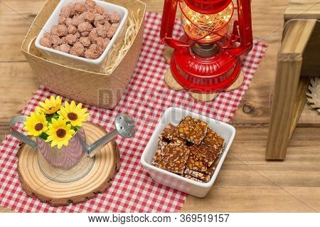Brazilian June Party Table Decorated With Delicious Typical Sweets. Sugary Peanut And Crunchy Peanut