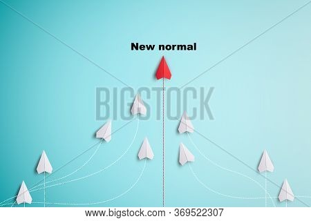 White Paper Plane Flying To Red Paper To Change Disrupt And Finding New Normal Way On Blue Backgroun