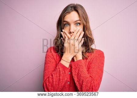 Young beautiful blonde casual girl over pink isolated background shocked covering mouth with hands for mistake. Secret concept.