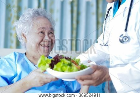 Asian Senior Or Elderly Old Lady Woman Patient Eating Breakfast Vegetable Healthy Food With Hope And