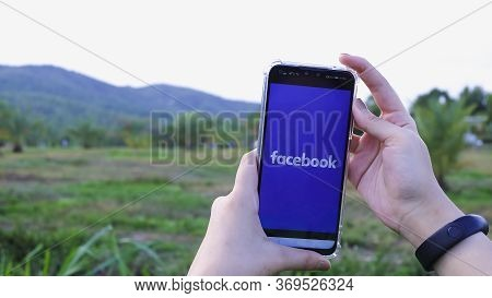 Chiang Mai Thailand. June 03, 2020. Women Holds Smart Phone With Facebook Application On The Screen.