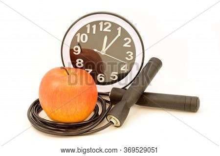 An Isolated Jump Rope With An Apple And Clock For A Variety Of Excersise Concepts.