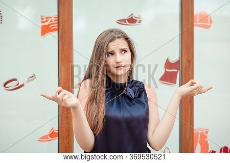 It Is Confusing. Portrait Dumb Looking Woman Arms Out Shrugs Shoulders I Don't Know What To Buy, Sto
