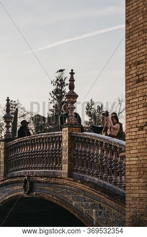 Seville, Spain - January 17, 2020: People Taking Photos On Stairs Of Plaza De Espana, A Plaza In The