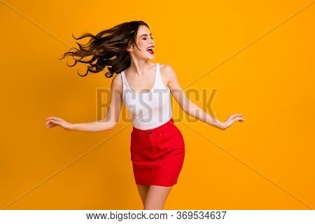 Photo Of Funny Carefree Cheerful Lady Rejoicing Summer Weekend Warm Breeze Blowing Walk Street Wear